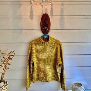 Soft and cozy two-tone sweater with mock neck